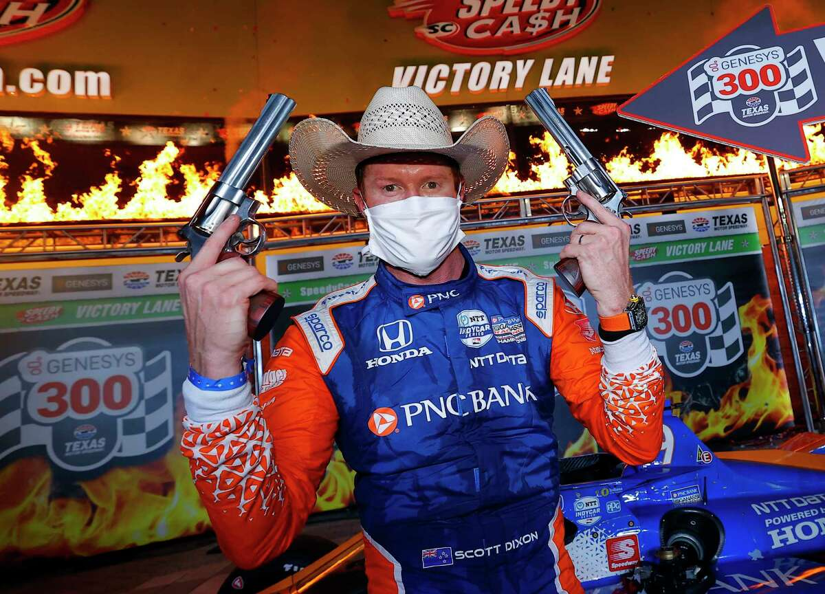 FORT WORTH, TEXAS - JUNE 06: Scott Dixon, driver of the #9 PNC Bank Chip Ganassi Racing Honda, celebrates in Victory Lane after winning the NTT IndyCar Series - Genesys 300 at Texas Motor Speedway on June 06, 2020 in Fort Worth, Texas. (Photo by Tom Pennington/Getty Images)