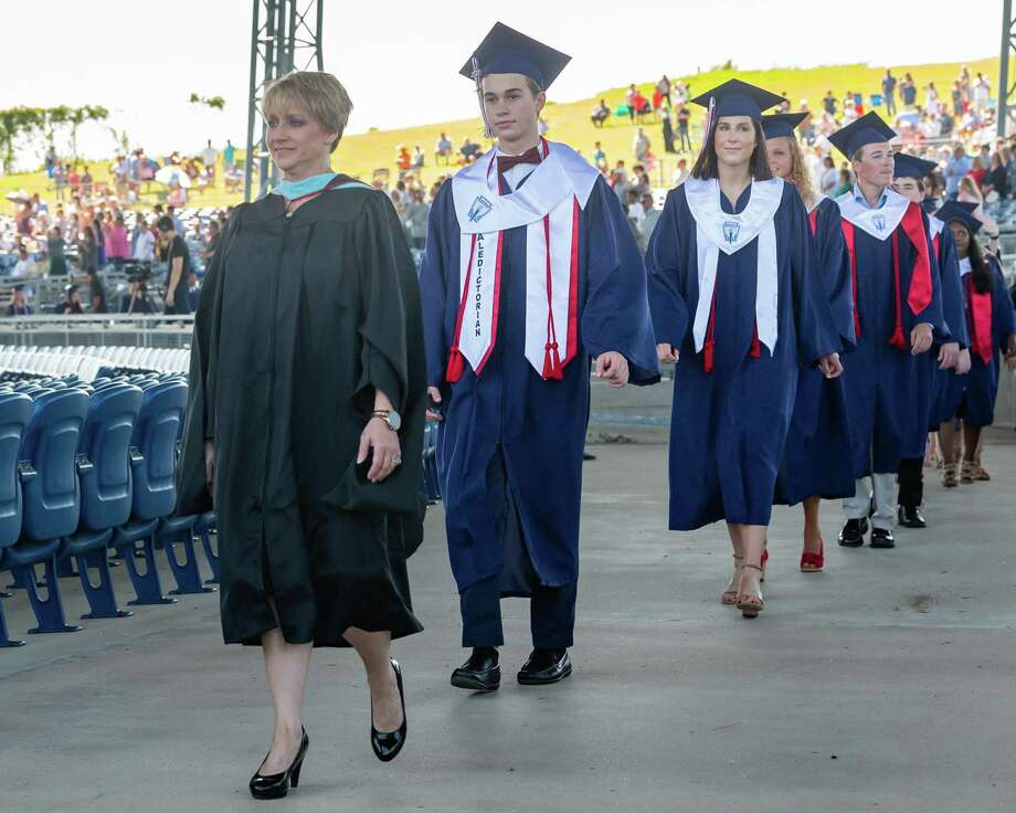 The senior class of Hardin-Jefferson High School processes into the Ford Park Pavilion on Saturday morning for their commencement. Photo made on June 6, 2020.  Fran Ruchalski/The Enterprise Photo: Fran Ruchalski, The Enterprise / The Enterprise / © 2020 The Beaumont Enterprise