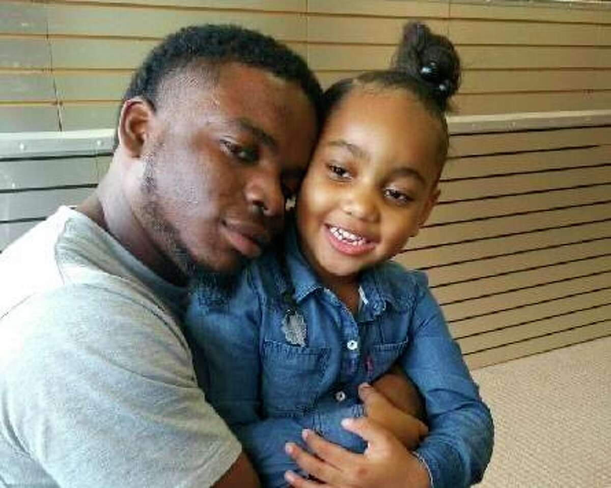 This file photo provided by the family of Michael Dean shows Dean with his daughter Te'yana. Dean was killed Dec. 2, 2019, in Temple, Texas, located 70 miles northeast of Austin. A Texas police officer who fatally shot Dean, an unarmed man, in the head in December opened fire while the pair had