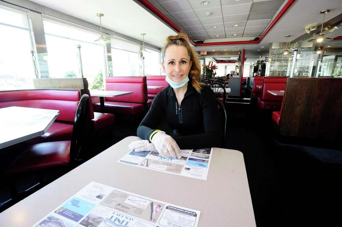 Lushe Gjuarj, owner of Lushe's Parkway Diner, is photographed on May 21, 2020 at her restaurant in Stamford, Connecticut.