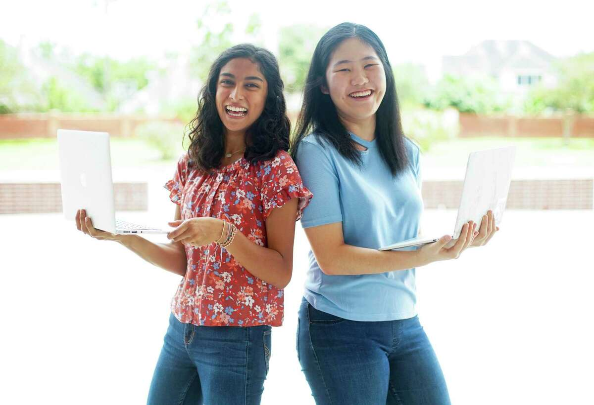 Raina Parikh, 15, left, and Tracy Wei, 16, were members of the Girls Who Code Club at their school and after three years developed and launched SAY: Stories About You. A mental health app allows kids to share their experiences from natural disasters. Photographed in Sugar Land on Friday, June 5, 2020.