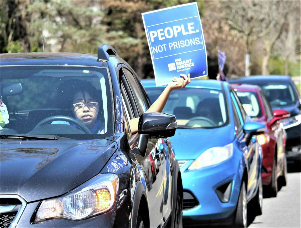 More than 50 cars gathered in front of the governor's Executive Residence in Hartford Monday, as protesters for prison release in the coronavirus crisis remained in their cars and honked, stopping traffic for about an hour.