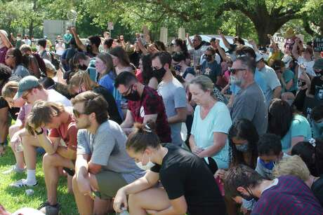 Residents from Friendswood and surrounding communities knelt on one knee and kept silent for 8 minutes and 46 seconds, the reported time that George Floyd was pinned by a police officer, during a a Black Lives Matter march along FM 518 in honor of Floyd Saturday, Jun. 6.