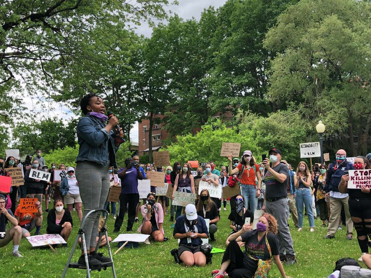 A speaker is featured in Congress Park in Saratoga Springs Sunday June 7, 2020 as part of a rally that drew hundreds of people demanding racial equality and an end to police brutality.