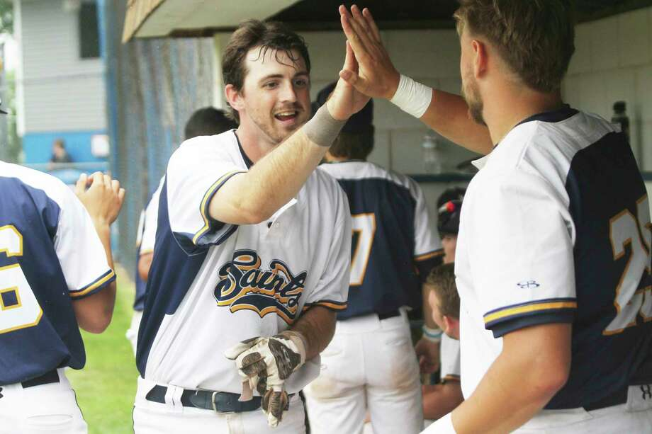 Roddy MacNeil celebrates a run last summer in the Manistee Saints dugout. (News Advocate file photo)