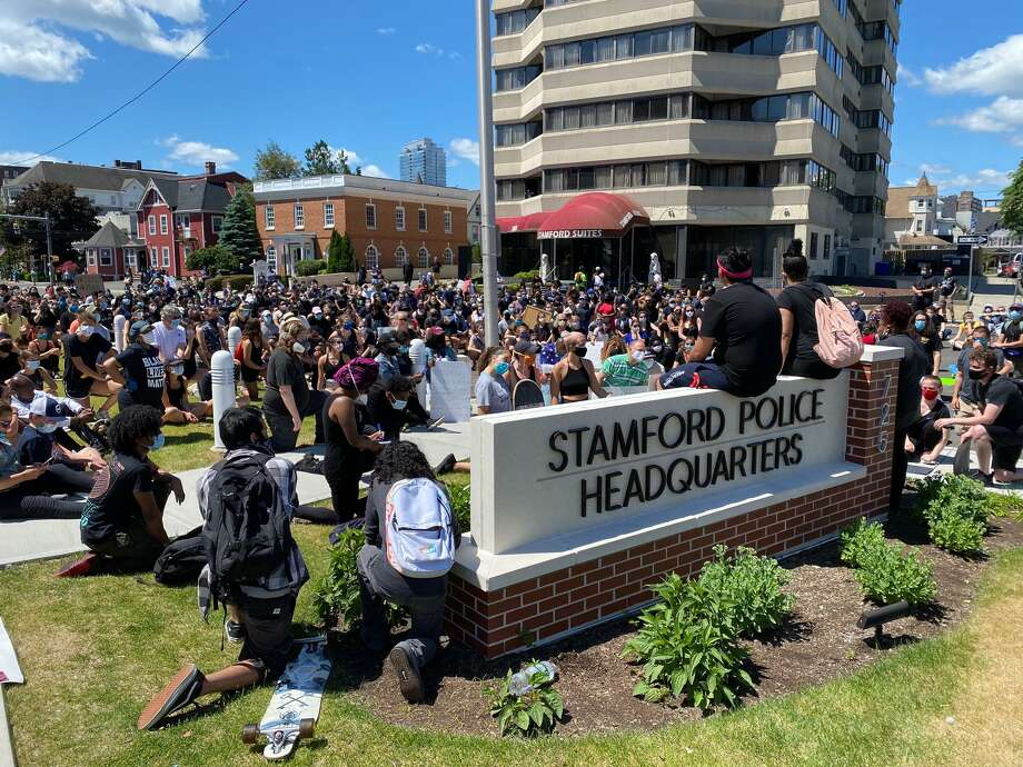 Protesters congregate in front of Stamford Police Headquarters Sunday. Photo: Tyler Sizemore / Staff Photo