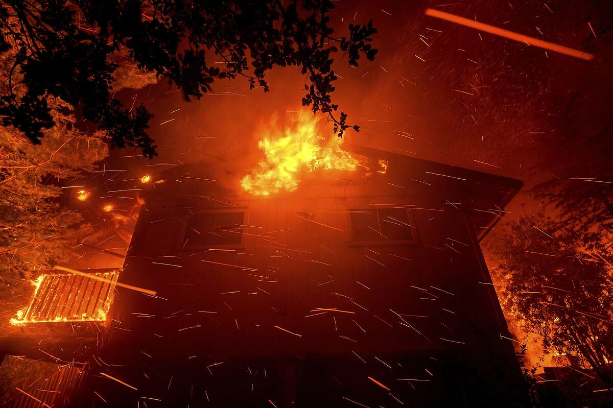 Flames consume a house as the Quail Fire burns near Winters, Calif., on Sunday, June 7, 2020. The blaze has burned at least 1,200 acres according to Cal Fire. (AP Photo/Noah Berger)