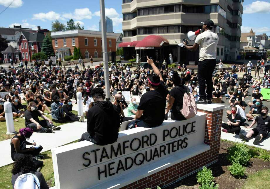 Stamford resident Carl Michel stands and delivers a speech during the Black Lives Matter protest at the Stamford Police Department in Stamford on Sunday. Photo: Tyler Sizemore / Hearst Connecticut Media / Greenwich Time