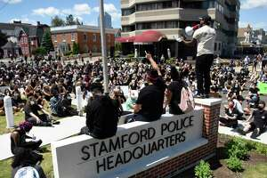Stamford resident Carl Michel stands and delivers a speech during the Black Lives Matter protest at the Stamford Police Department in Stamford on Sunday.