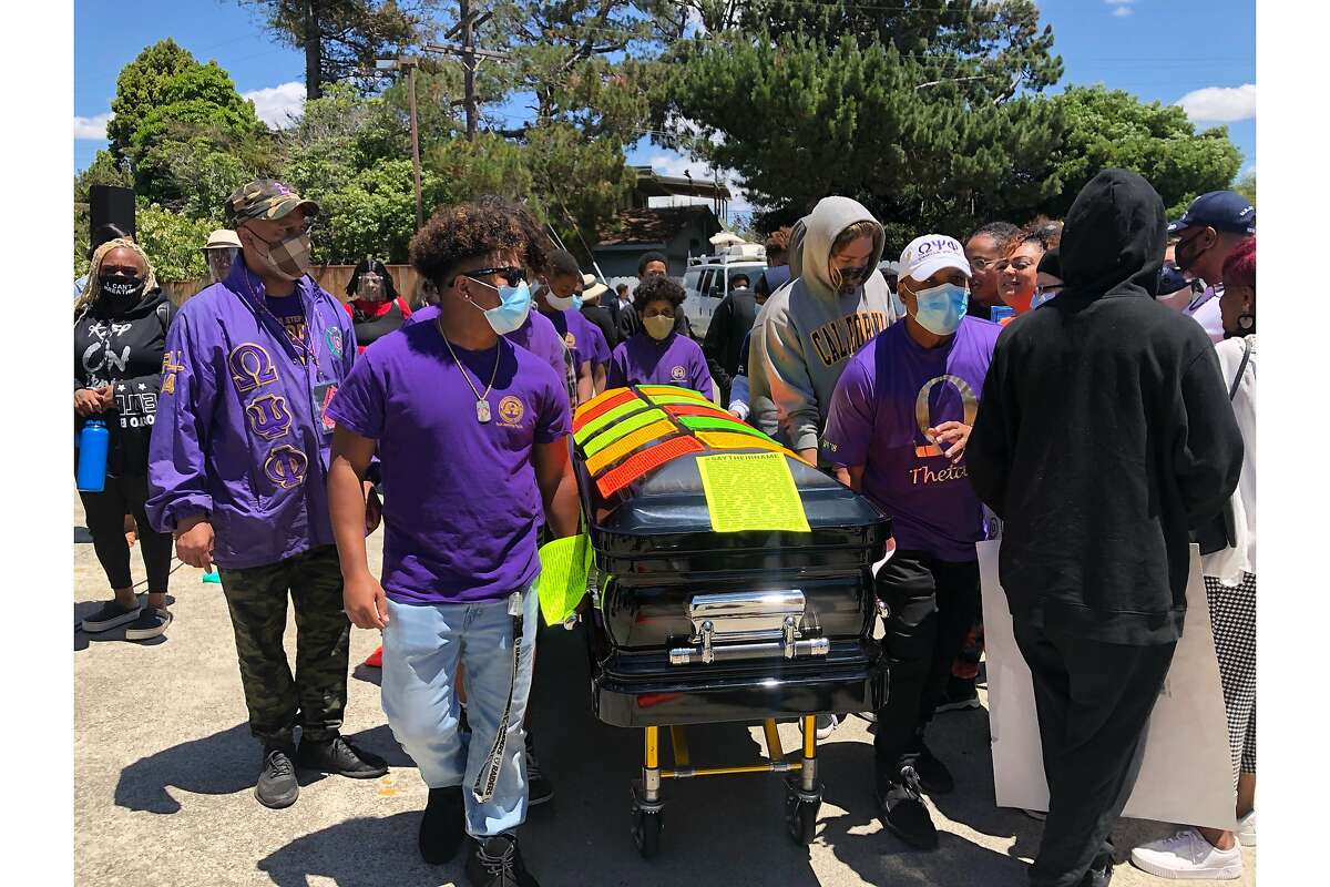 People participate in a Black Lives Matter march in Vallejo, Calif., on Sunday, June 7, 2020. Some are pulling a coffin to symboilze people killed by police.