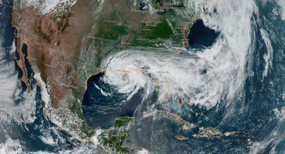 """This satellite image obtained from NOAA/RAMMB, shows Tropical Storm Cristobal just south of New Orleans at 19:50 UTC on June 7 18, 2020, as it moves northward at 12 miles per hour (19 kph). - Tropical Storm Cristobal rumbled northward through the Gulf of Mexico on June 7, on track to bring powerful winds, damaging storm surges and heavy rains to Louisiana when it makes landfall later in the day, the US National Hurricane Center said. (Photo by Handout / NOAA / AFP) / RESTRICTED TO EDITORIAL USE - MANDATORY CREDIT """"AFP PHOTO / NOAA """" - NO MARKETING - NO ADVERTISING CAMPAIGNS - DISTRIBUTED AS A SERVICE TO CLIENTS (Photo by HANDOUT/NOAA/AFP via Getty Images) Photo: HANDOUT, Contributor / NOAA/AFP Via Getty Images / AFP or licensors"""