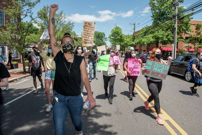 Hundreds gathered in Darien Sunday afternoon for a Black Lives Matter protest which featured predominantly young people's voices.