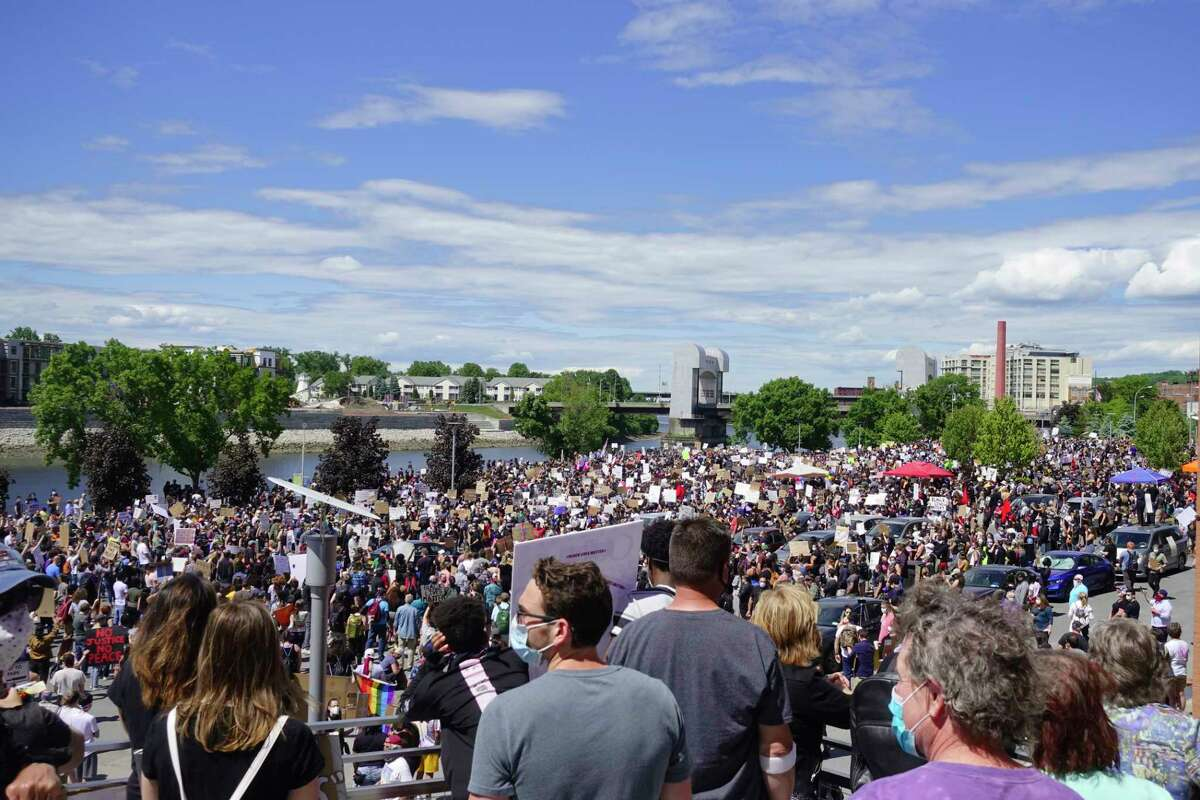 People gather in Riverfront Park for the Black Lives Matter rally on Sunday, June 7, 2020, in Troy, N.Y. (Paul Buckowski/Times Union)