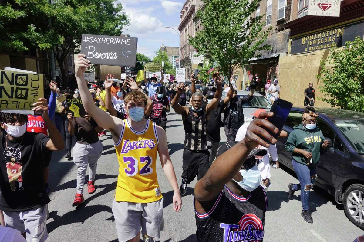 Protesters march along 3rd St. during a Black Lives Matter rally on Sunday, June 7, 2020, in Troy, N.Y. (Paul Buckowski/Times Union)