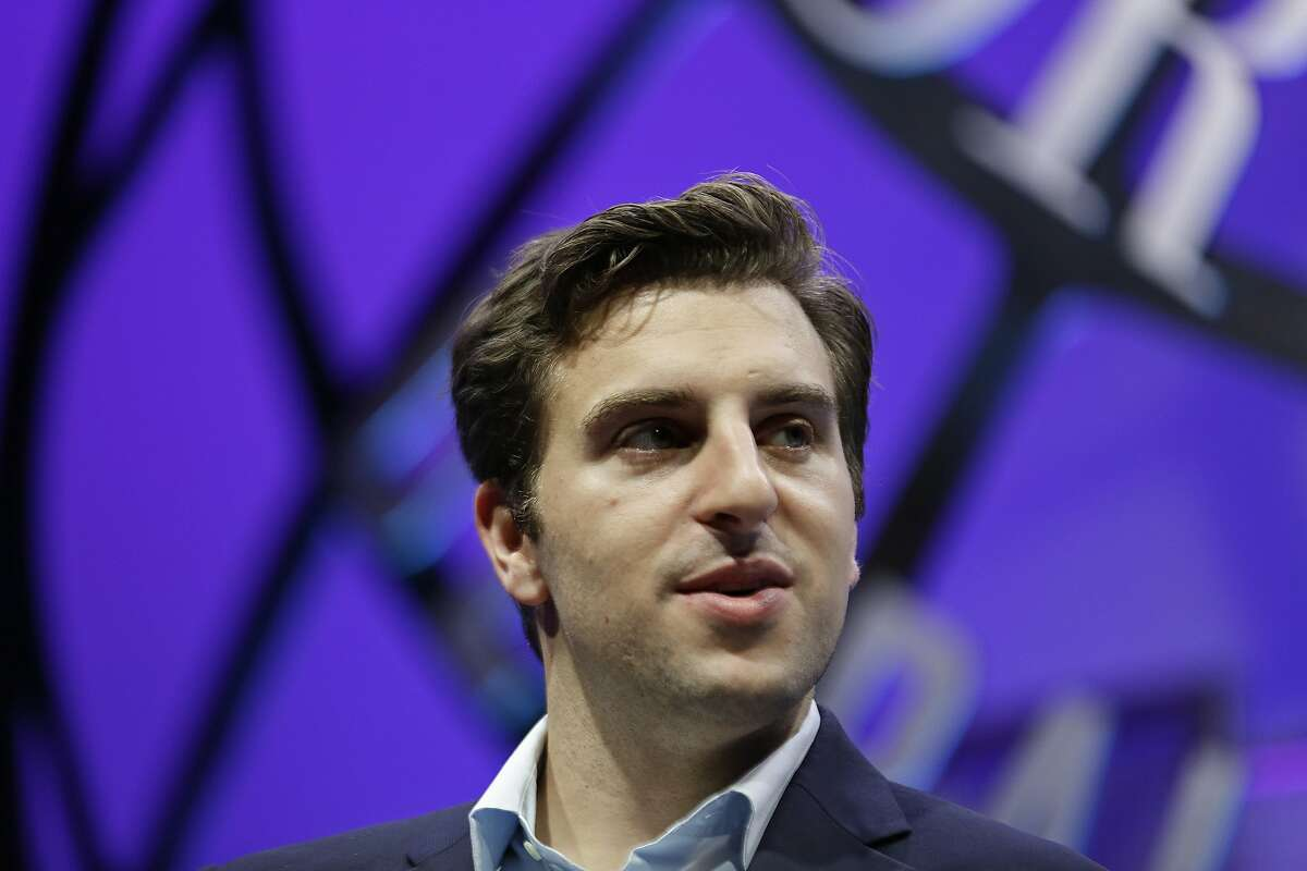 FILE - In this Nov. 4, 2015 file photo, Airbnb co-founder and CEO Brian Chesky listens to a question at the Fortune Global Forum in San Francisco. Airbnb says it will be blocking and canceling all reservations in the Washington, D.C. area during the week of the presidential inauguration.