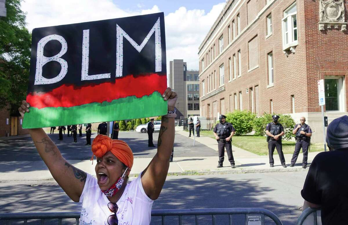 Protesters chant outside the Troy Police Department during a Black Lives Matter rally on Sunday, June 7, 2020, in Troy, N.Y. (Paul Buckowski/Times Union)