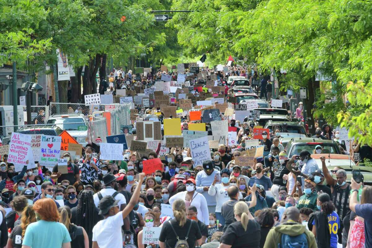 Protesters make their way up Congress St. on their way to the Troy Police Department during a Black Lives Matter rally on Sunday, June 7, 2020, in Troy, N.Y. (Paul Buckowski/Times Union)