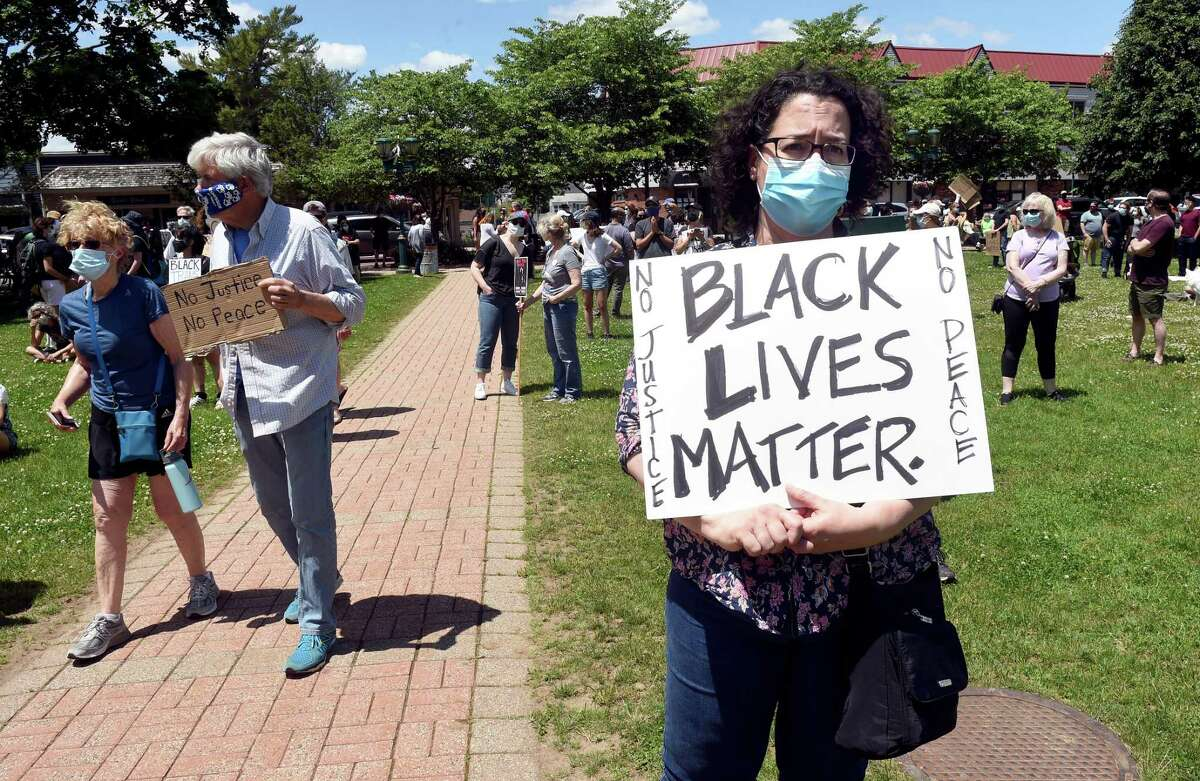 Angela Meikle of East Haven (right) participates in a Black Lives Matter protest on the Branford Green on June 7, 2020.