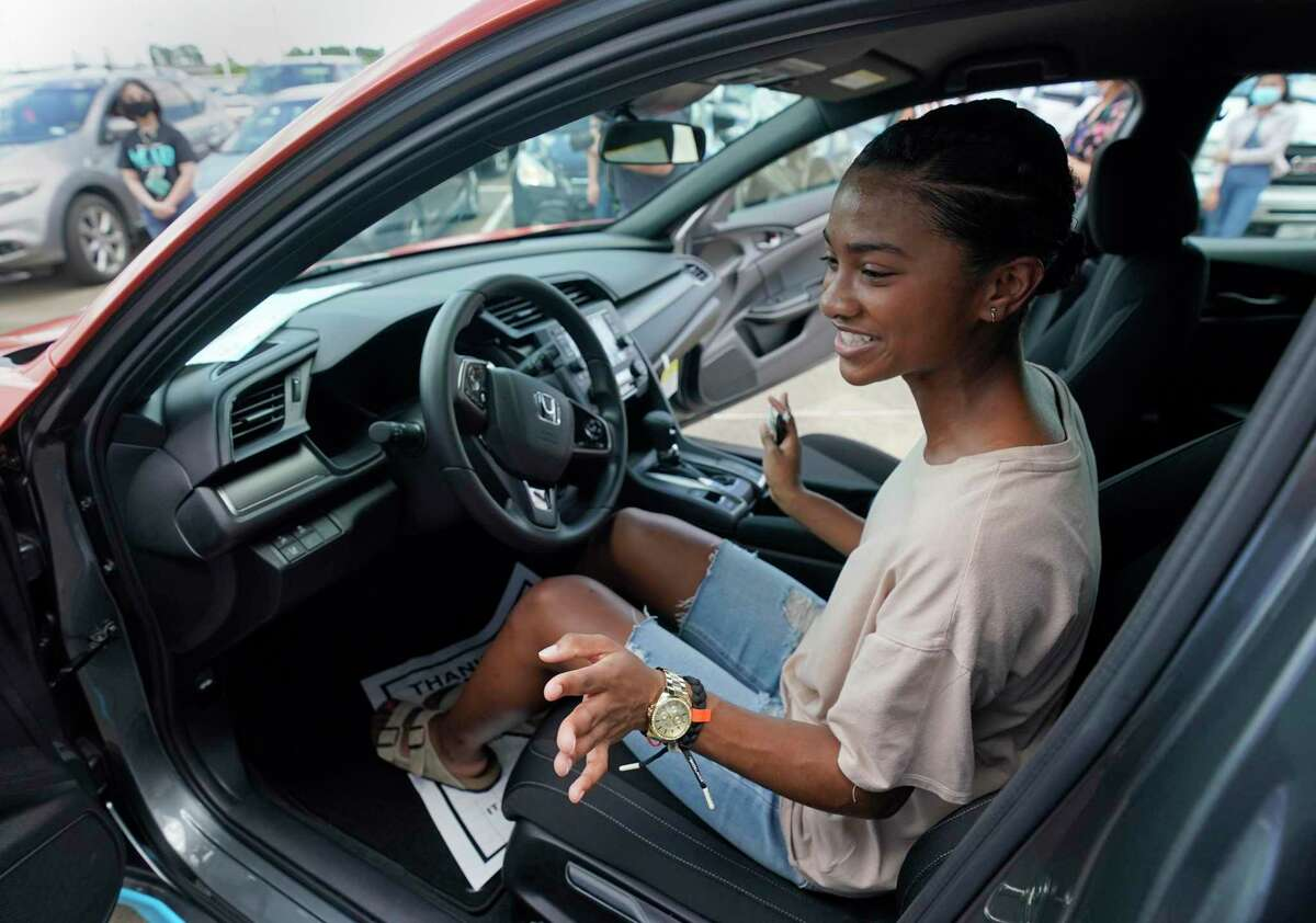 Erion Spencer, 18, a Wunsche High School senior, sits in her new Honda Civic LX she won in the district's annual Smart Kid Cool Car contest during a program held at Honda of Spring, 17350 North Fwy., Sunday, June 7, 2020, in Houston. 215 Spring ISD seniors were eligible by meeting a list of requirements such as maintaining a cumulative 2.5 GPA, passing all state-required End of Course exams, maintaining a 95 percent attendance rate during the year, and completing 25 hours of volunteer service in the Spring community.