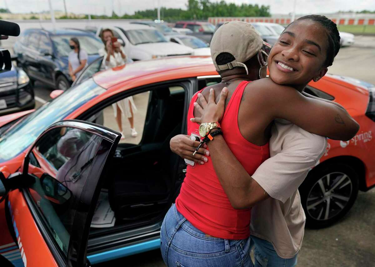 Tameca Spence, left, hugs her daughter, Erion Spencer, 18, a Wunsche High School senior, after she won a new Honda Civic LX in the district's annual Smart Kid Cool Car contest during a program held at Honda of Spring, 17350 North Fwy., Sunday, June 7, 2020, in Houston. 215 Spring ISD seniors were eligible by meeting a list of requirements such as maintaining a cumulative 2.5 GPA, passing all state-required End of Course exams, maintaining a 95 percent attendance rate during the year, and completing 25 hours of volunteer service in the Spring community.
