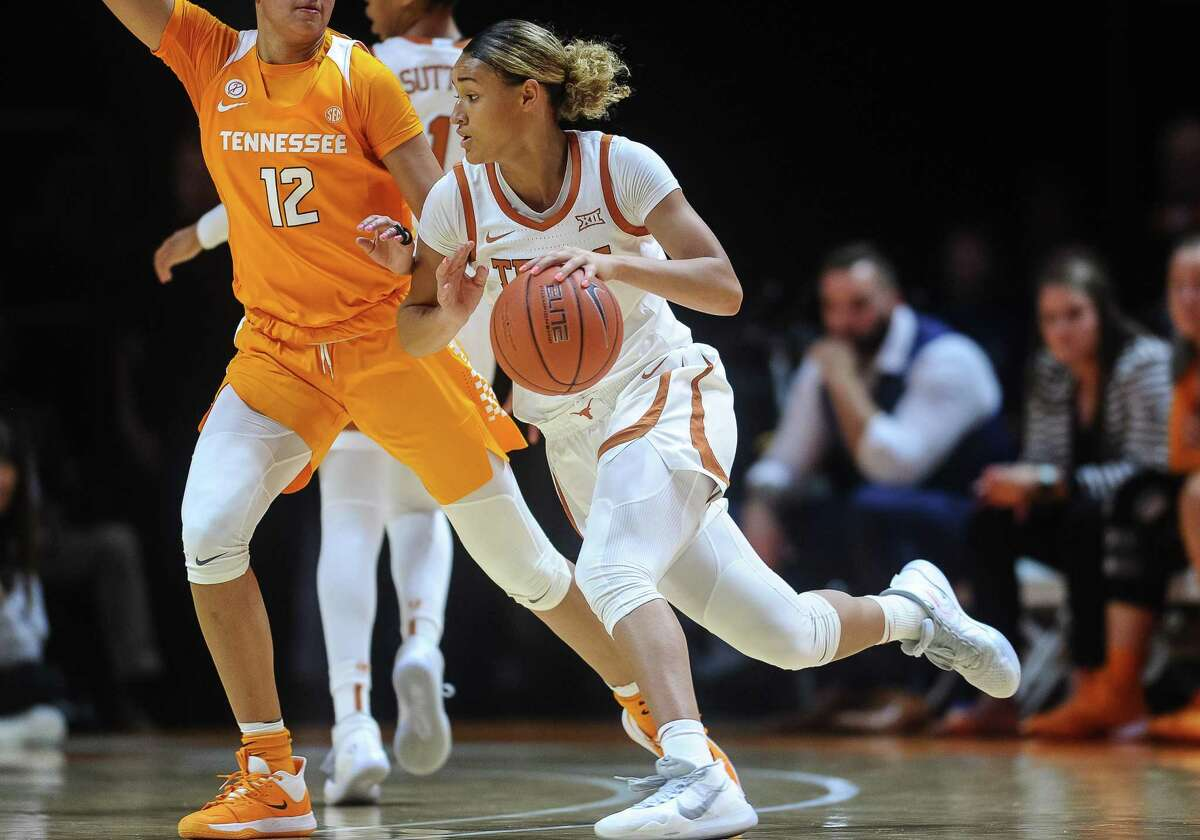 KNOXVILLE, TN - DECEMBER 08: Texas Longhorns guard Celeste Taylor (0) drives around Tennessee Lady Vols guard Rae Burrell (12) during a college basketball game between the Tennessee Lady Vols and Texas Longhorns on December 8, 2019, at Thompson-Boling Arena in Knoxville, TN. (Photo by Bryan Lynn/Icon Sportswire via Getty Images)