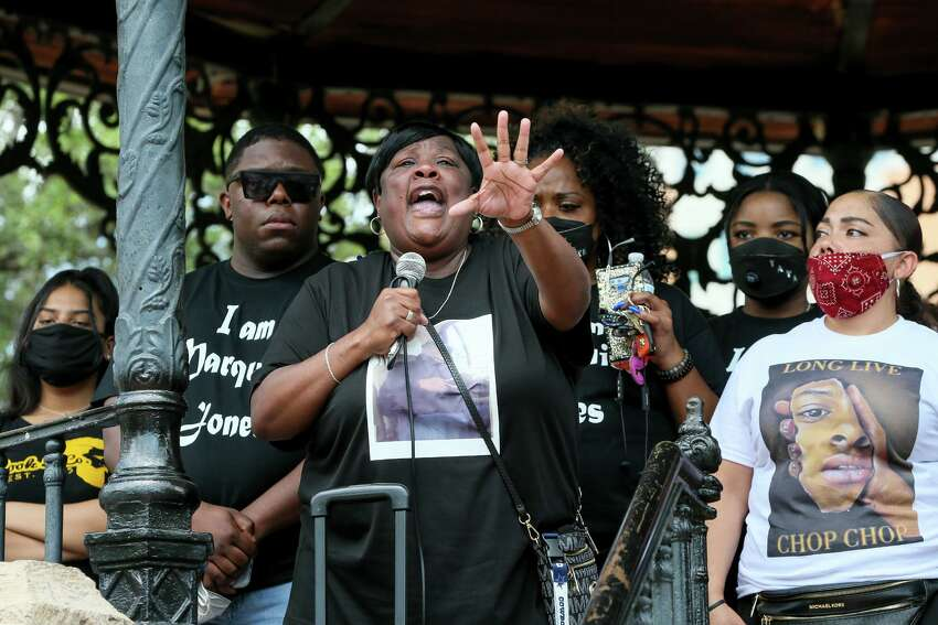 Debbie Bush, center, aunt of Marquise Jones, speaks during a vigil at Milam Park for Charles