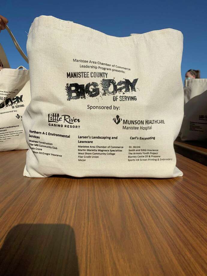 Members of the Manistee Area Chamber of Commerce Leadership Programhanded out over 250 bags of food during this year's Big Day of Serving on Saturday. (Courtesy Photo)