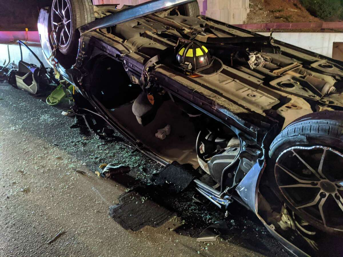 One person who was trapped in a vehicle that rolled over on the southbound Merritt Parkway was extricated by firefighters Sunday night on May 7, 2020. A second occupant in the vehicle was able to climb out of the vehicle before first responders arrived. Once extrication was complete, the vehicle began to smoke and caught fire.