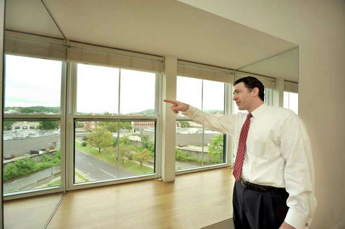 Dan Bertram,of BRT Corperation, points out the view from the fifth floor at Brookview Commons in Danbury, Monday, Aug. 23, 2010.