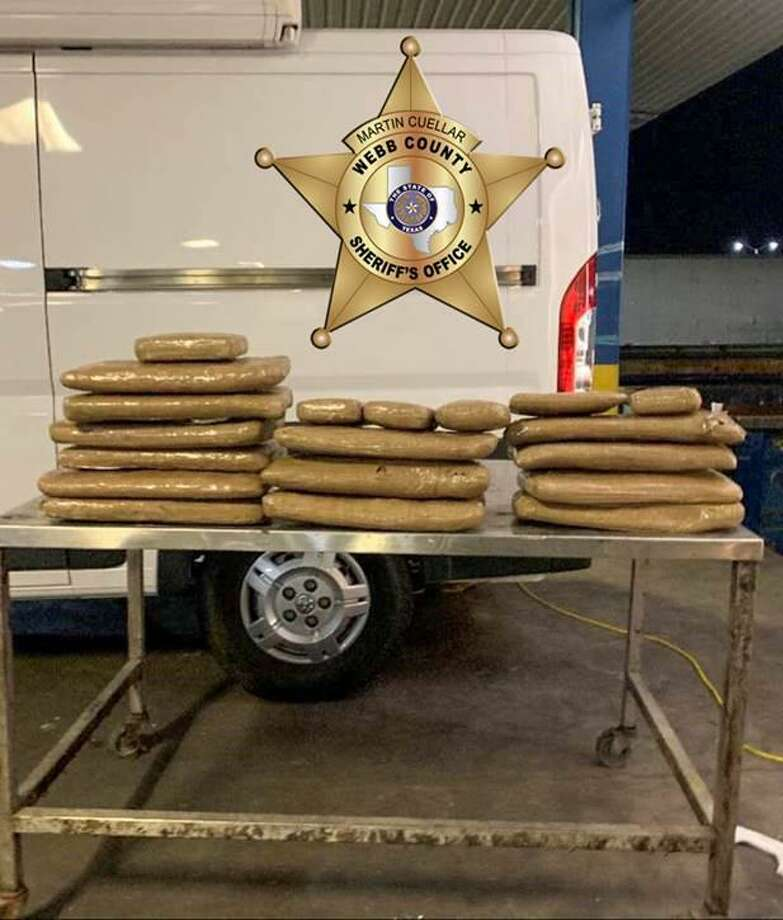 Pictured are 19 bundles of drugs including heroin, crystal meth and pseudoepherine that were seized from a tractor-trailer by the Sheriff's Office. Photo: Courtesy Of The Webb County Sheriff's Office