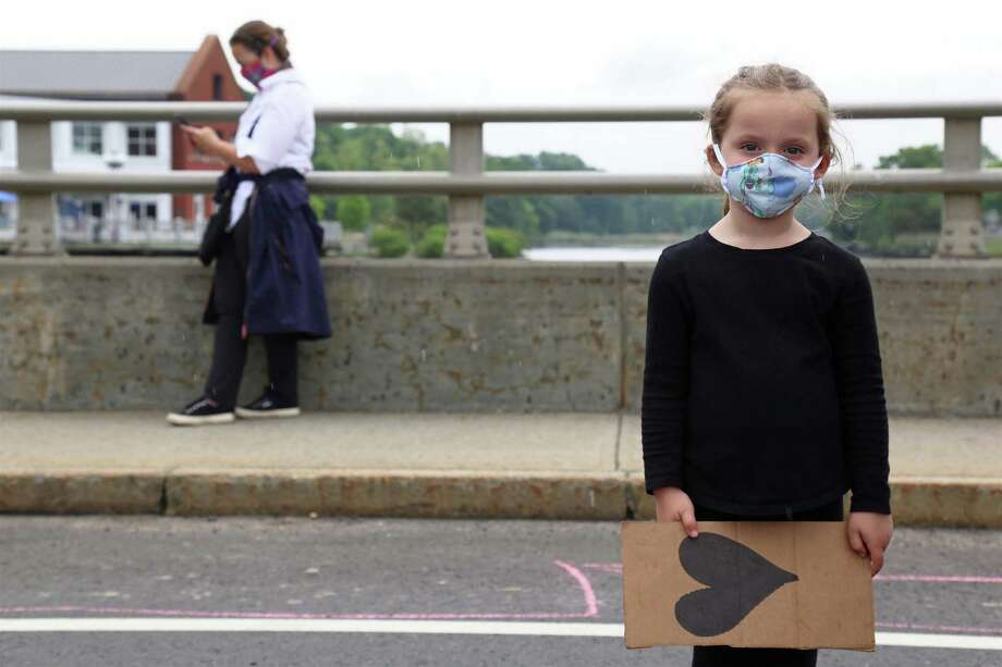 Reese Klein, 5, of Southport, at the protest on the Ruth Steinkraus Bridge on the Post Road on Friday, June 5, 2020, in Westport, Conn. Photo: Jarret Liotta / Jarret Liotta / ©Jarret Liotta 2020