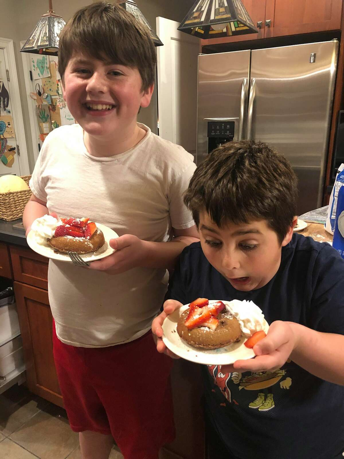 From left, Santino and Michael Bailey with homemade chocolate lava cakes.