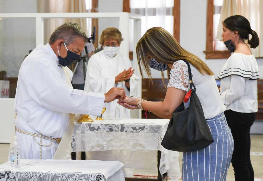 Parishioners of San Agustin Church commune, Sunday, Jun 7, 2020, after Sunday Mass at the old San Augustine High School's Santa Monica Hall. Sunday was the first day the Diocese of Laredo held an in person mass since its closing due to the COVID-19 coronavirus pandemic. Photo: Danny Zaragoza/Laredo Morning Times