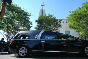 A hearse, carry the remains of George Floyd, pulls up in front of The Fountain of Praise Church in Houston on Monday, June 8, 2020.