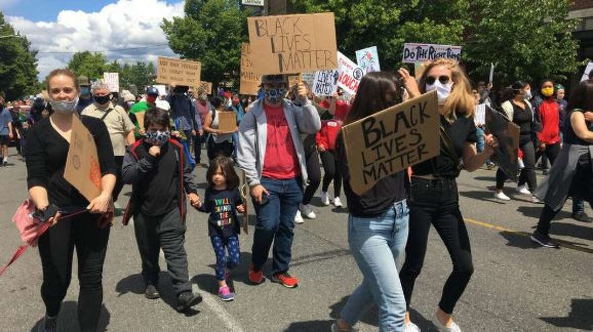 Hundreds march in West Seattle on Saturday, June 6.