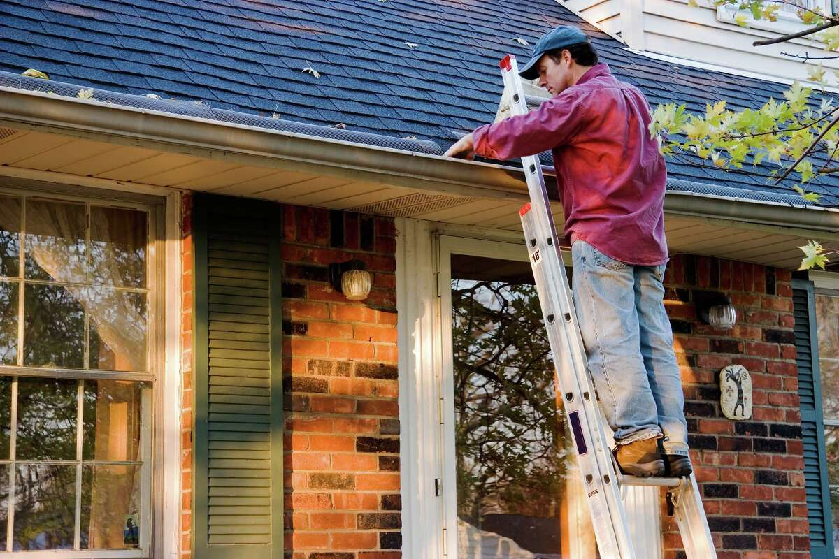 Cleaning the gutters is an essential Fall cleanup.