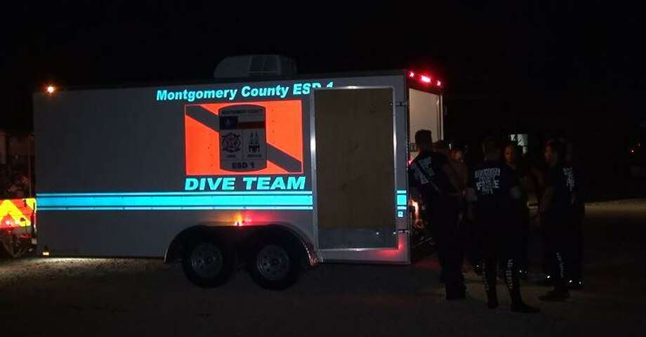 Divers are seen Sunday night during a search for a woman who drowned on Lake Conroe. Photo: Courtesy Of The Montgomery County Police Reporter