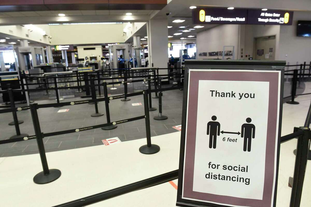 Social distancing signs are seen throughout the terminal of the Albany International Airport on Monday, June 8, 2020 in Colonie, N.Y. (Lori Van Buren/Times Union)