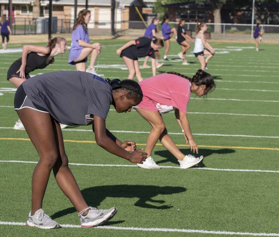 Midland High volleyball players spread out across the turf field at San Jacinto Junior High 06/08/2020 for the first day UIL has allowed organized workouts since mid-March. Tim Fischer/Reporter-Telegram Photo: Tim Fischer/Midland Reporter-Telegram
