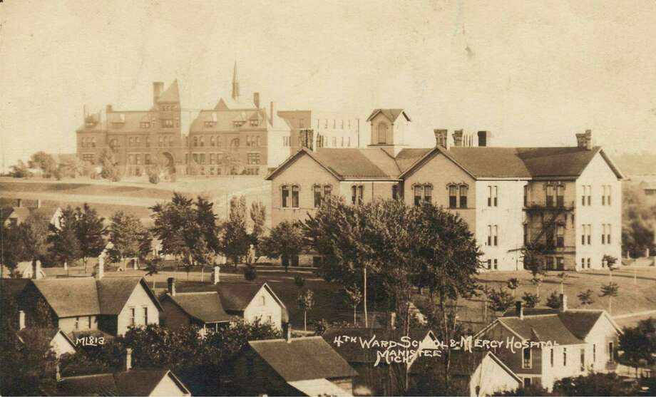 A view of Mercy Hospital in the background and the Fourth Ward School, circa 1905.