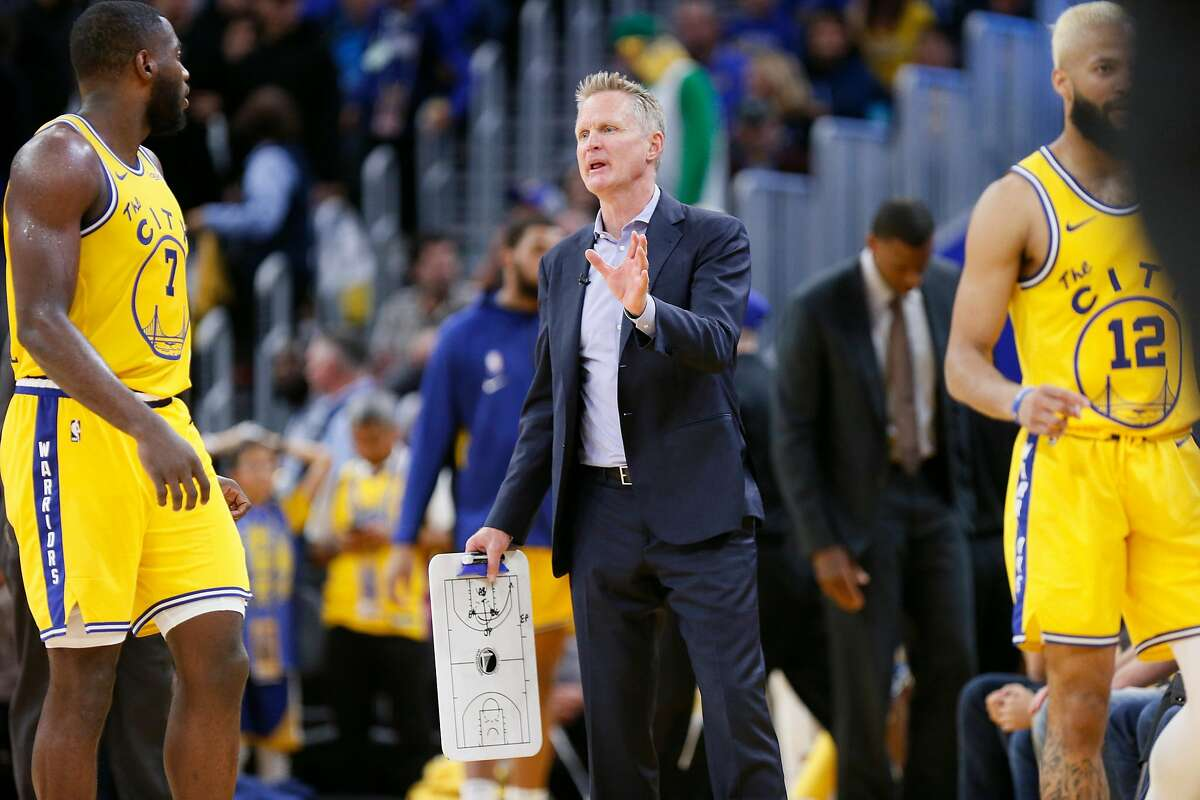 Golden State Warriors head coach Steve Kerr with Eric Paschall (7) in the second period of an NBA game against the Boston Celtics at Chase Center on Friday, Nov. 15, 2019, in San Francisco, Calif. The Celtics won 105-100.