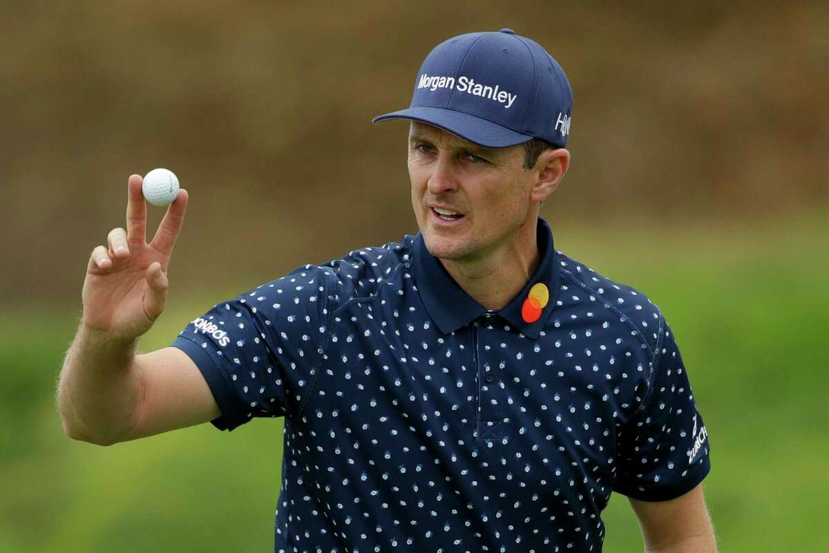 Justin Rose, of England, waves after his putt on the eighth hole during the second round of the U.S. Open golf tournament on June 14, 2019, in Pebble Beach, Calif.