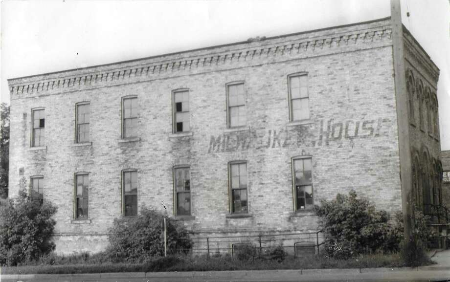 A view of the east side of The Milwaukee House circa 1950s. The building was constructed in 1874 and was originally owned and operated by Charles Diefenbach.