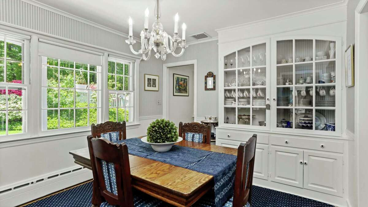 The formal dining room features a large built-in china cabinet.