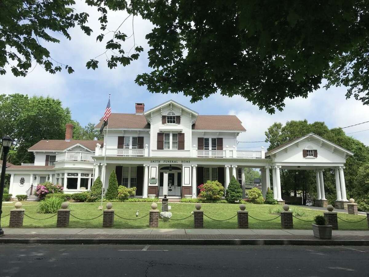 The Smith Funeral Home, founded by George J. Smith, on the Milfor Green since 1886, is targeted for development.