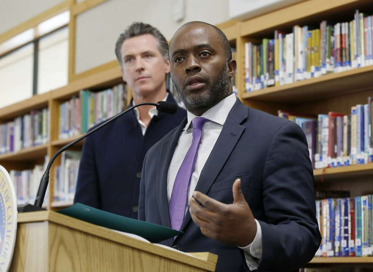 State Superintendent of Public Instruction Tony Thurmond answers a reporter's question during a visit with California Gov. Gavin Newsom, background, to Blue Oak Elementary School in Cameron Park, Calif.