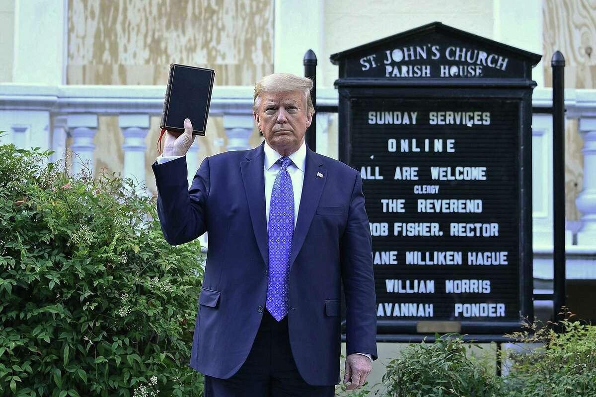 U.S. President Donald Trump holds up a Bible outside St. John's Episcopal church across Lafayette Park in Washington, D.C., June 1.