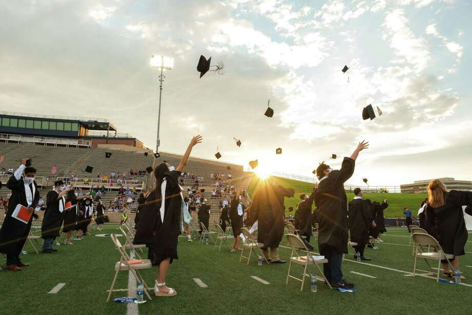 The new graduates from the Westchester Academy for International Studies class of 2020 throw their caps at the conclusion of the graduation ceremony on June 6 at Darrell Tully Stadium Photo: Spring Branch Independent School District