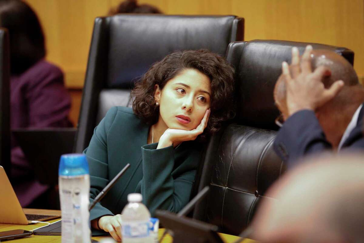 Harris County Judge Lina Hidalgo talks to Commissioner Rodney Ellis during the Harris County Commissioners Court Tuesday, March 10, 2020, in Houston.