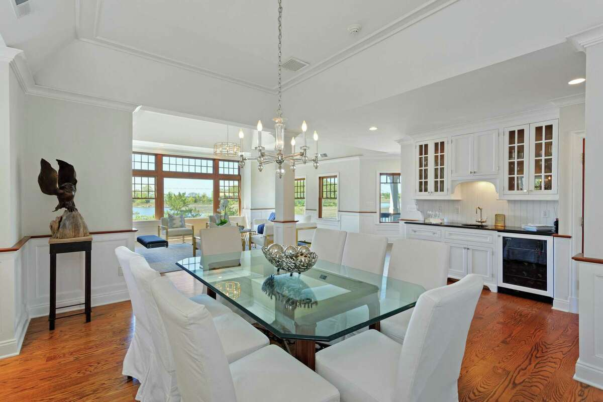 In the formal dining room there is a long granite counter with a wet bar.